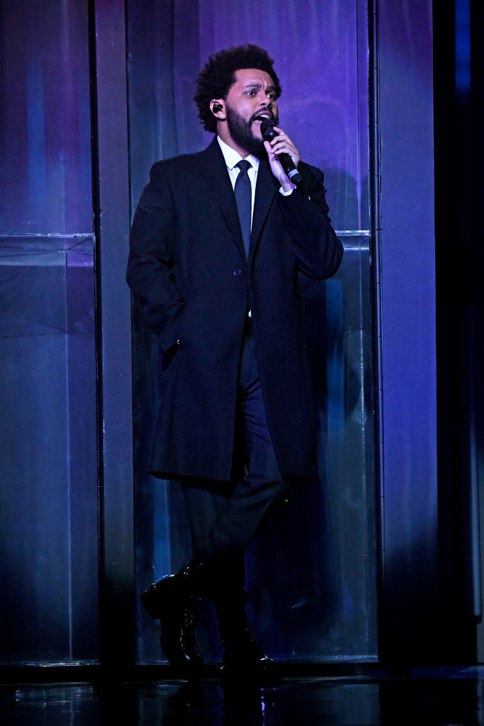 The Weeknd performs onstage at the 2021 iHeartRadio Music Awards in a suit