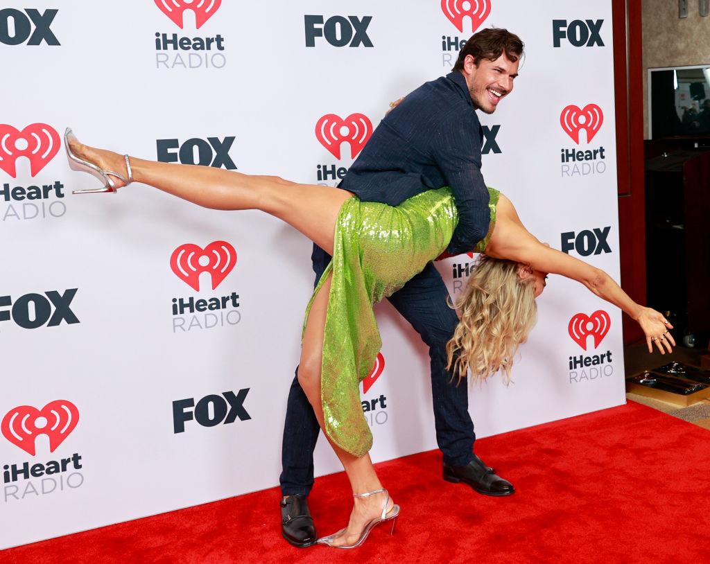 Gleb Savchenko playfully dips Nikki Glaser on the red carpet