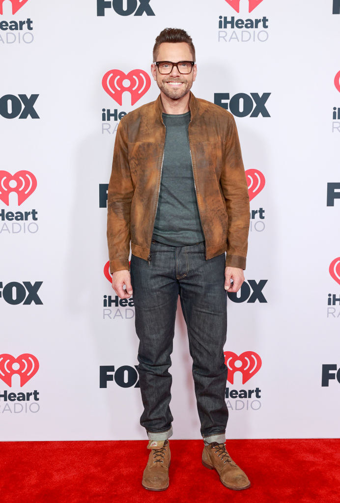 Joel McHale wore jeans and a leather jacket