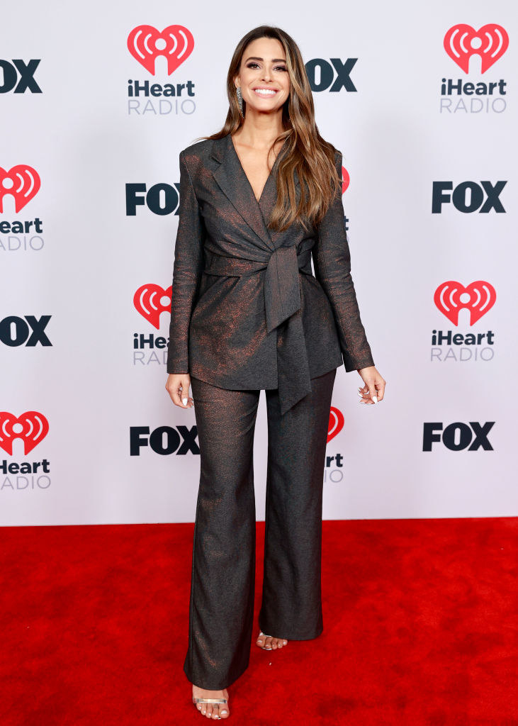 Jennifer Lahmers attends the 2021 iHeartRadio Music Awards in matching blazer and wide-eyed pants