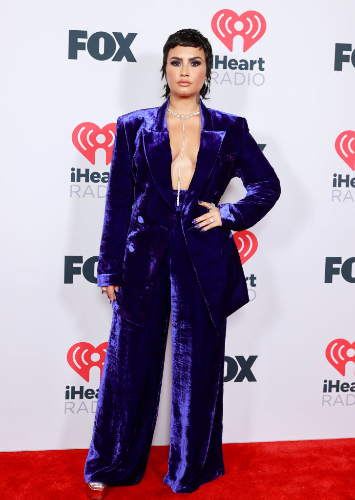 Demi Lovato attends the 2021 iHeartRadio Music Awards in a velour suit