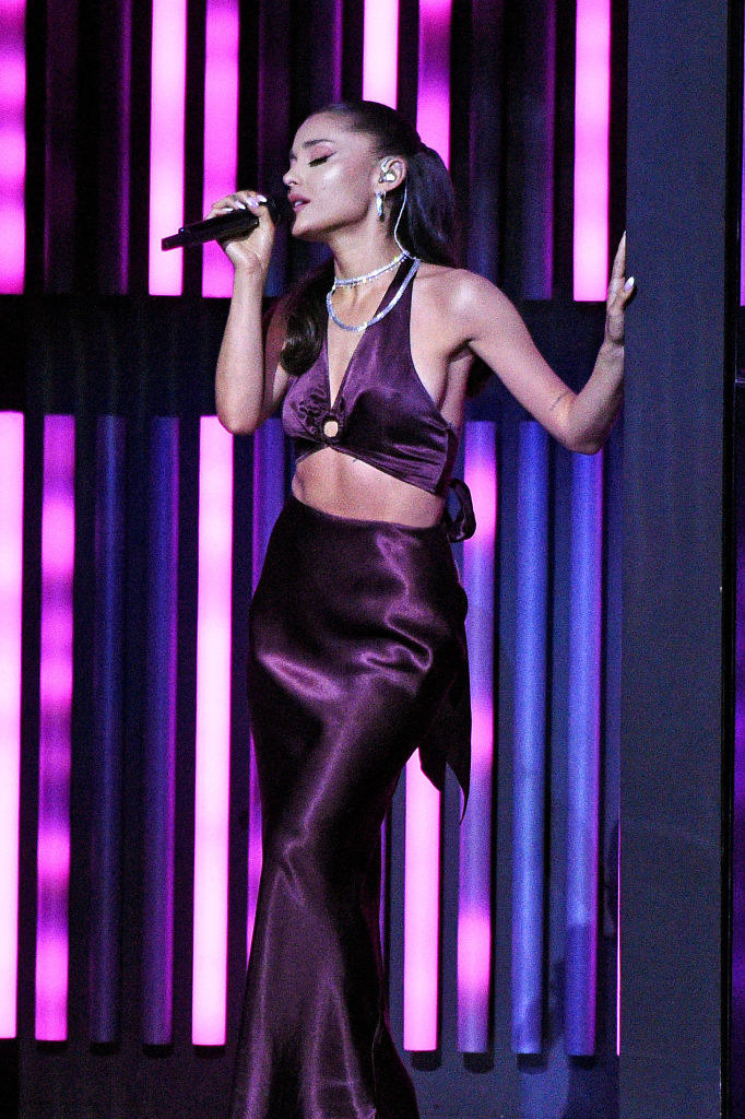 Ariana Grande performs onstage at the 2021 iHeartRadio Music Awards in a satin gown