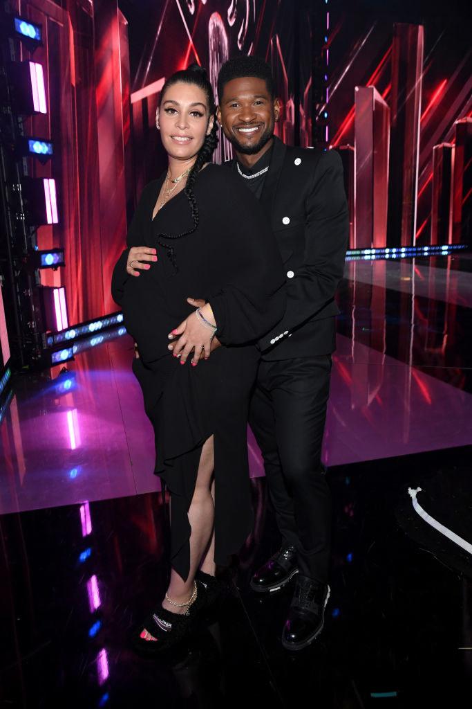 (L-R) Jennifer Goicoechea and Usher attend the 2021 iHeartRadio Music Awards in all black