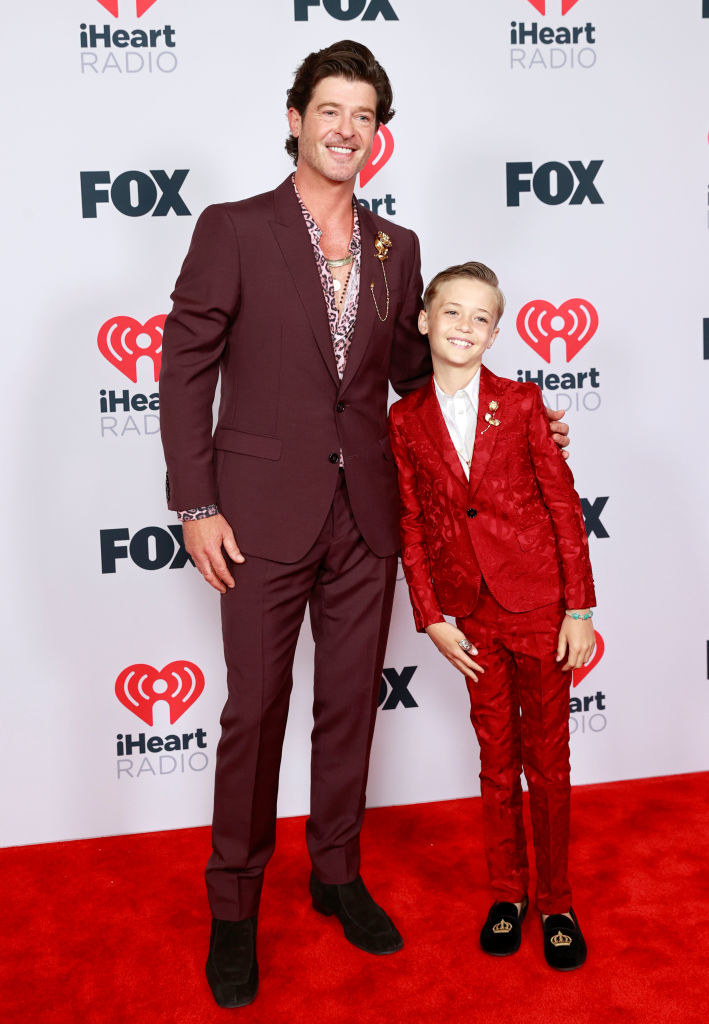 (L-R) Robin Thicke and Julian Fuego Thicke rock suits at the 2021 iHeartRadio Music Awards