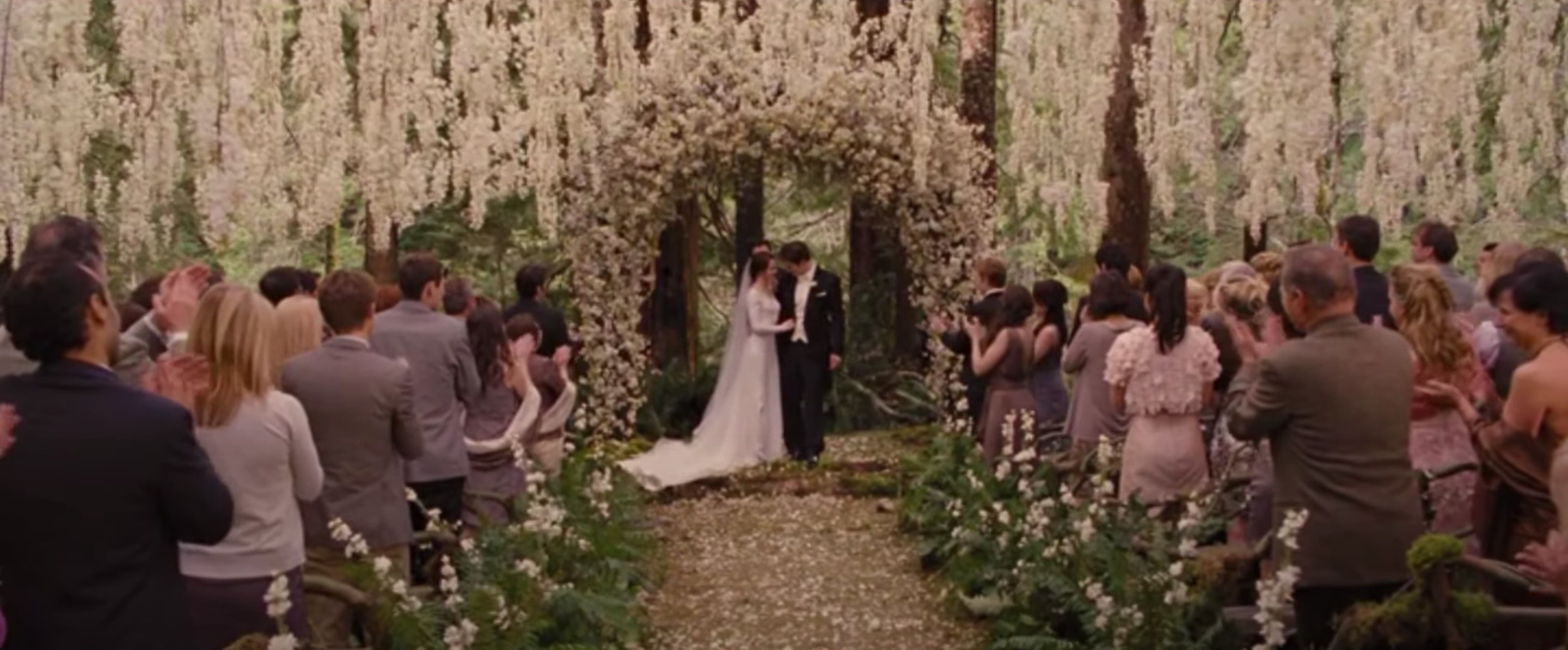 Bella and Edward standing at the altar