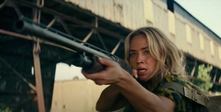 Evelyn Abbott holding a shotgun