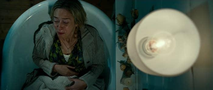 Woman grimacing in a tub
