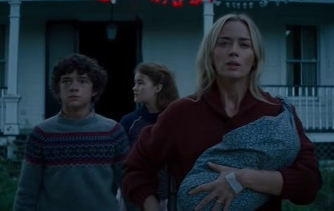 Abbott family walking away from house, Evelyn holding the baby