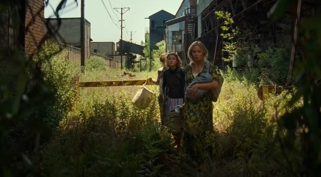 Abbot family walking in abandoned town
