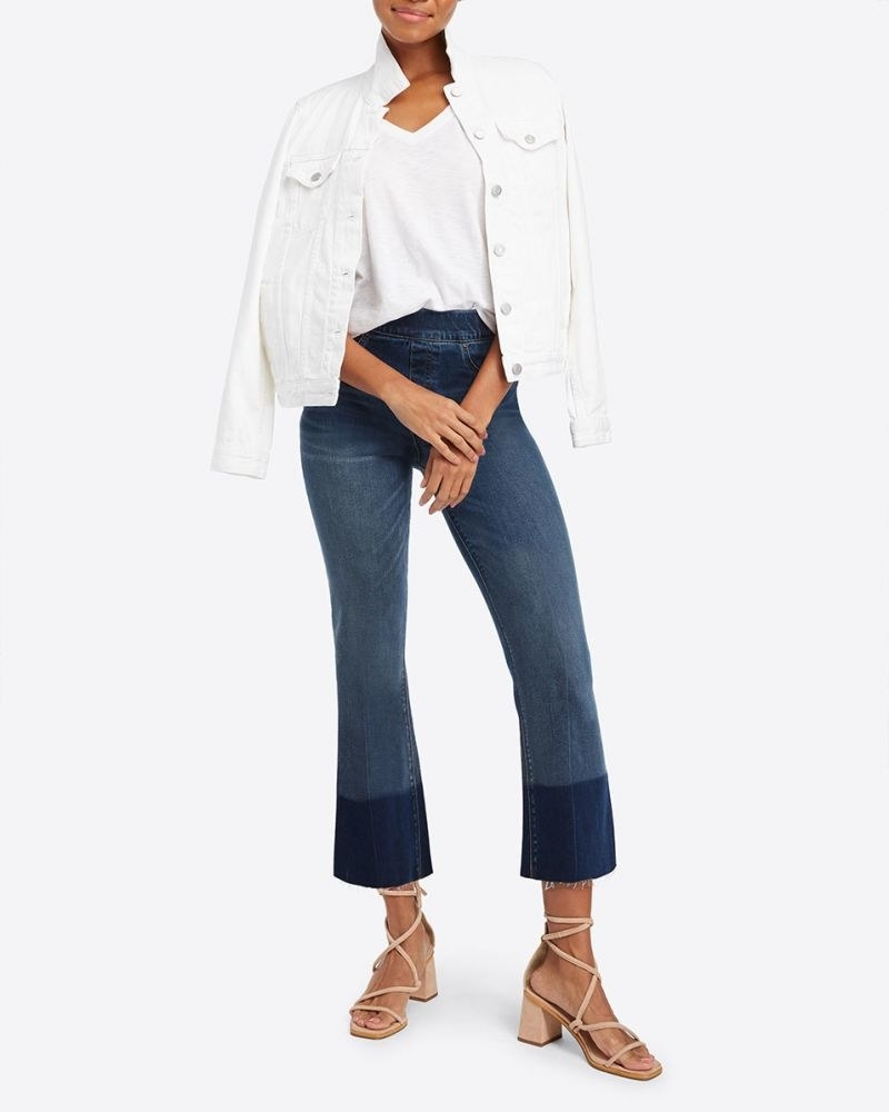 model wearing cropped flare blue jeans