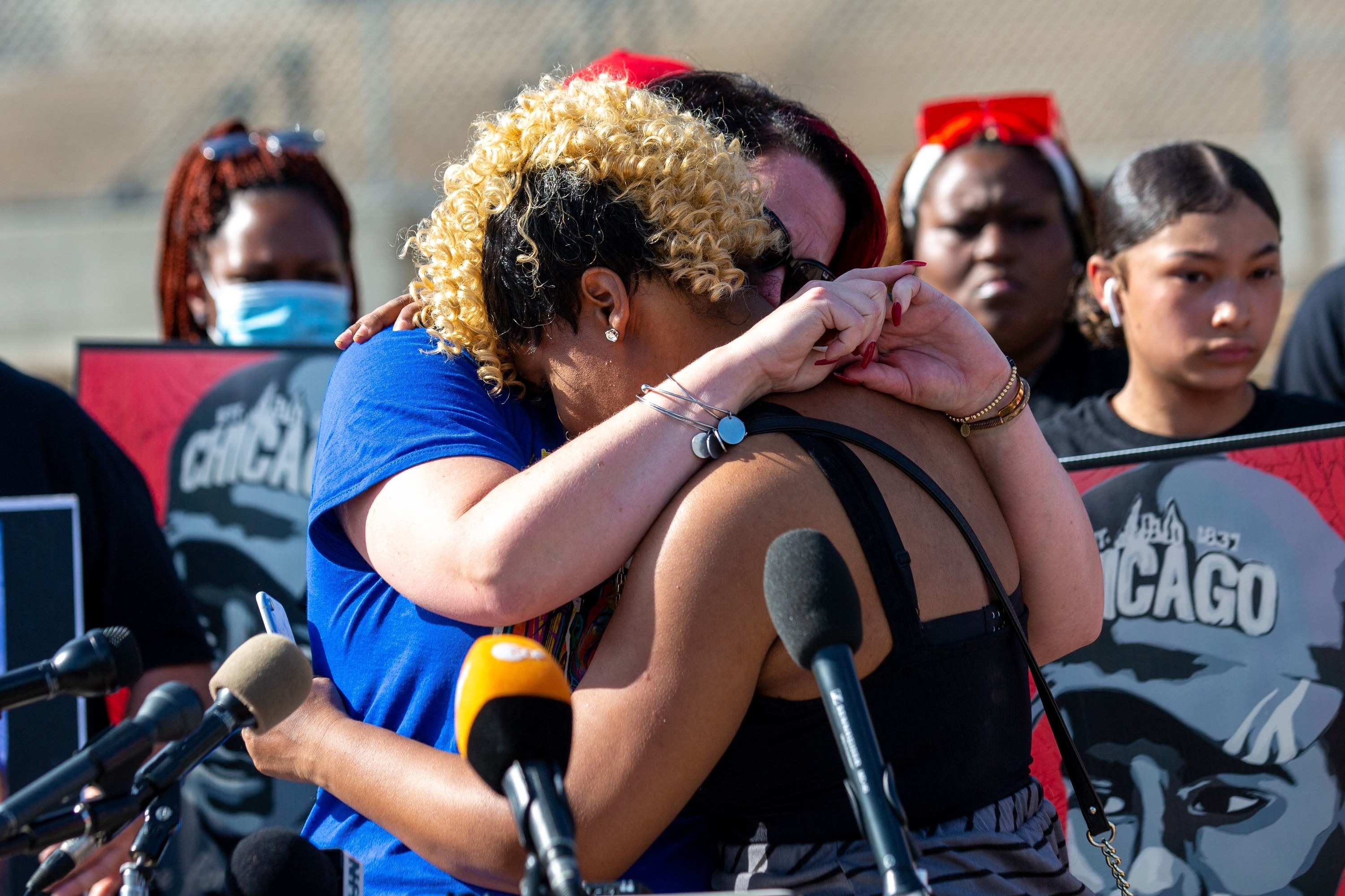 Courteney Ross, the fiancé of George Floyd, hugs Toshira Garraway during a remembrance event and call for justice for those who lost loved ones to police violence outside the Minnesota State Capitol on May 24, 2021, in St. Paul