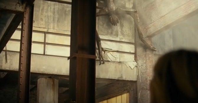 Long-limbed monster climbing down wall