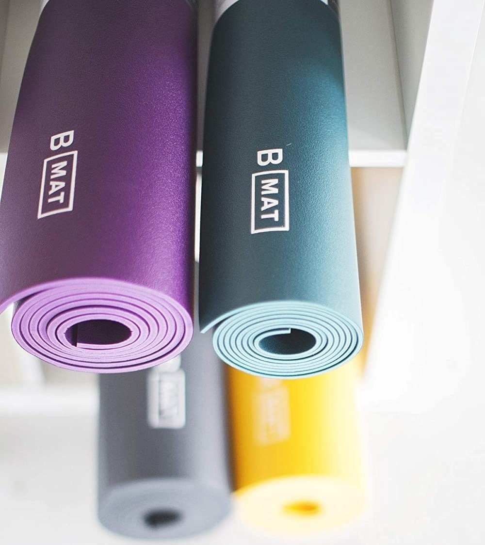 Two rolled up yoga mats