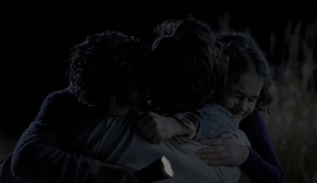 Regan and Marcus hugging their father