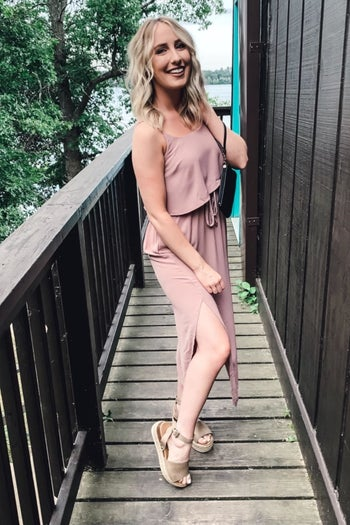 A different reviewer wearing the dress in pale pink