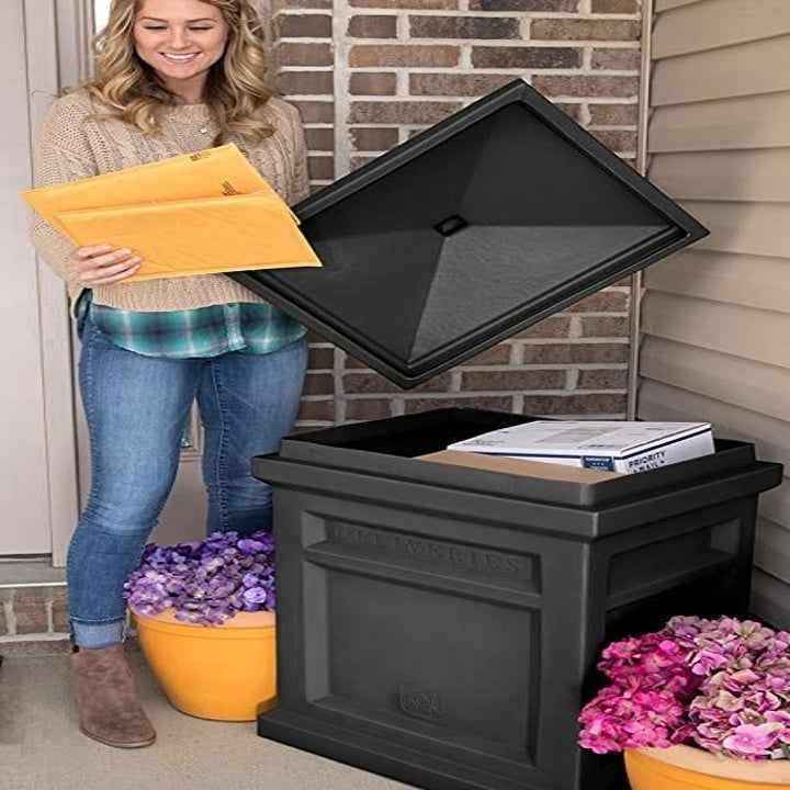 a model lifting the lid off the box filled with packages