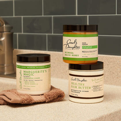 jars of hair products on bathroom counter