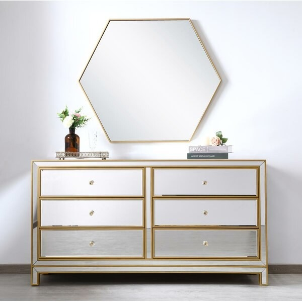 The dresser with a mirror over it