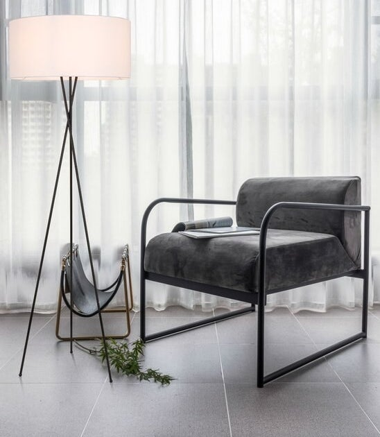 The lamp in black with a chair