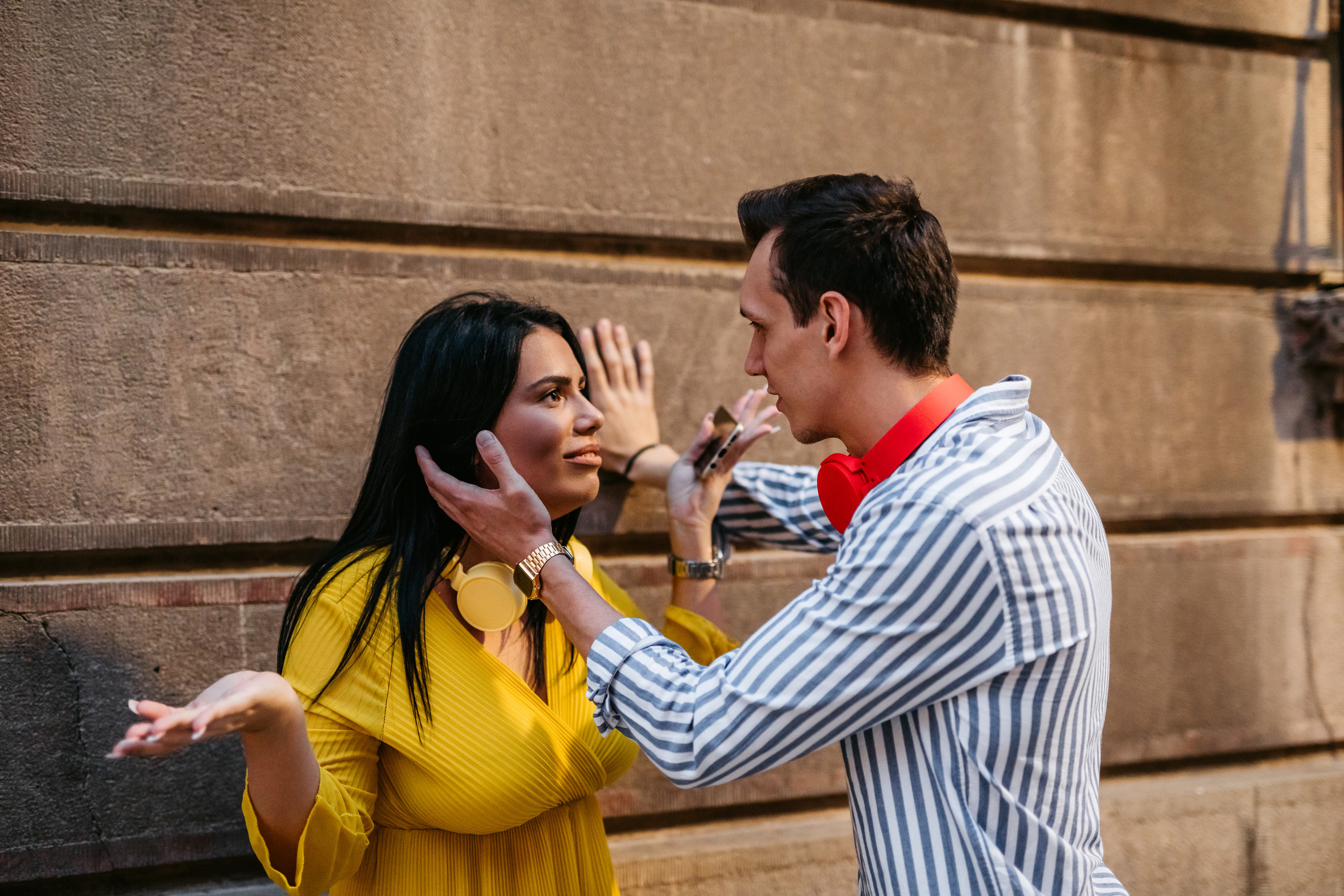 Photo of a girl and a guy arguing