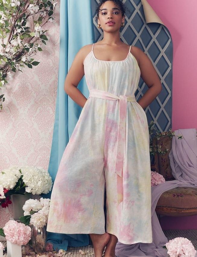 model wearing the jumpsuit in pastel tie dye