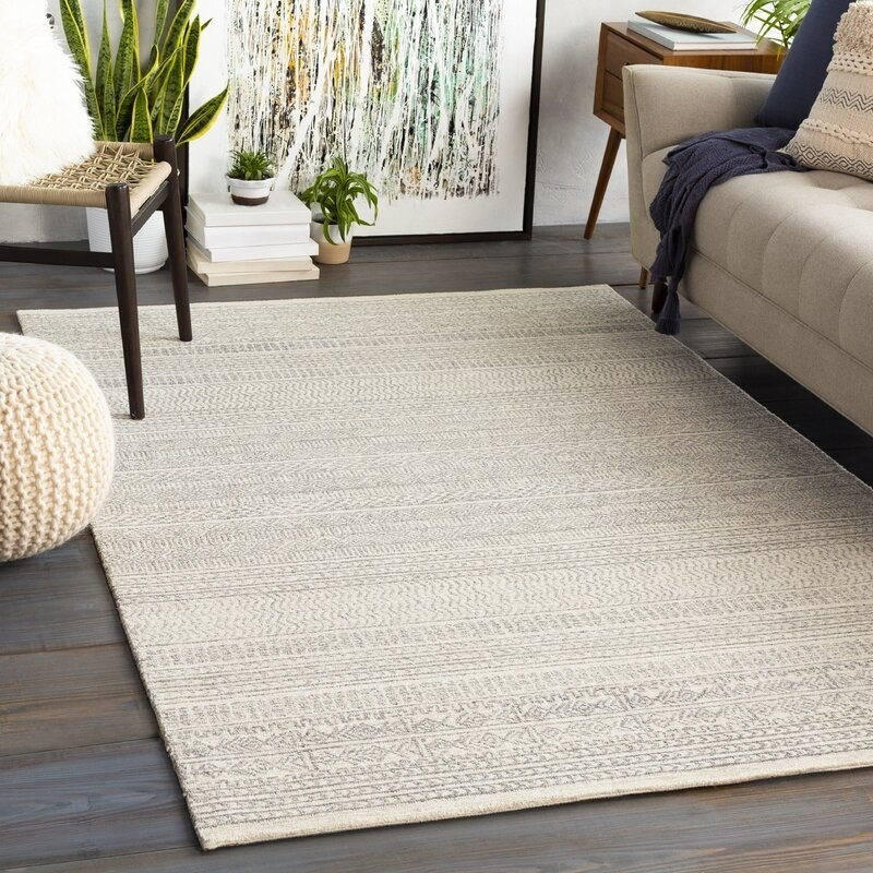 The rug in off-white