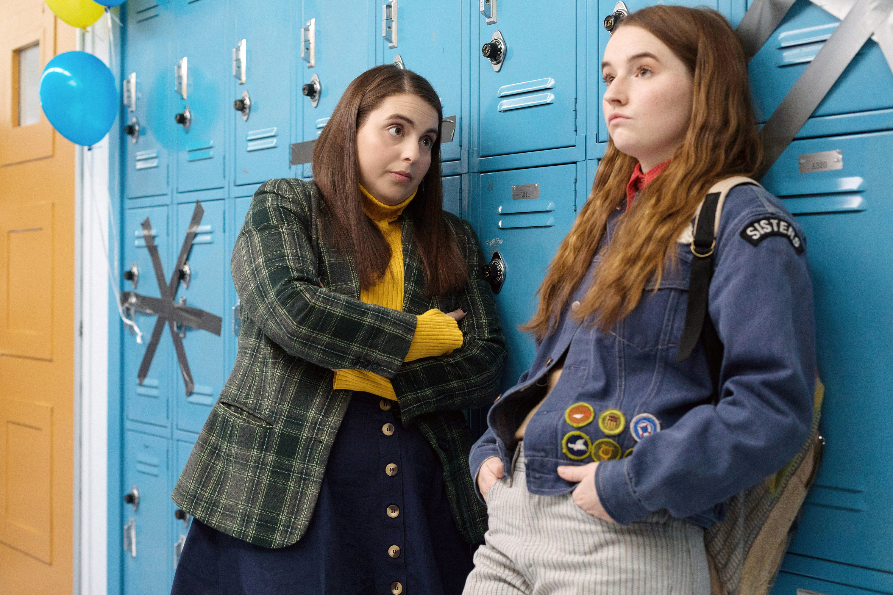 Amy and Molly leaning against lockers