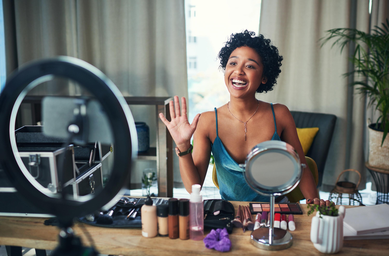 Photo of an Influencer recording a makeup video