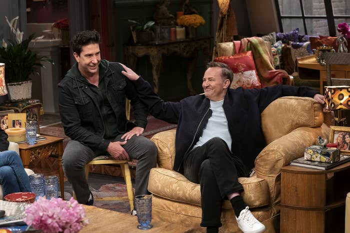 Perry puts his hand on David Schwimmer's shoulder during the Friends reunion