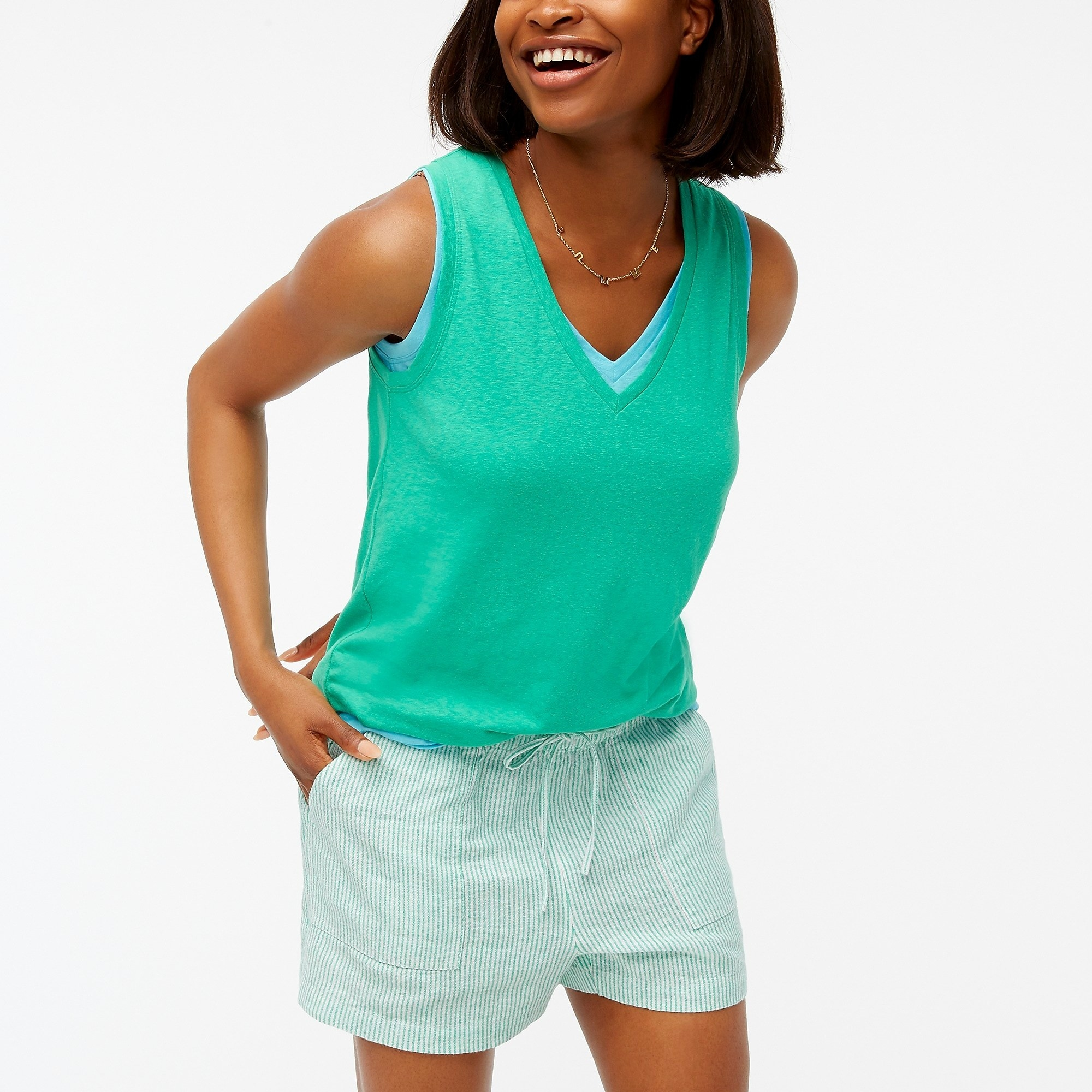 model wearing the tank in green with shorts