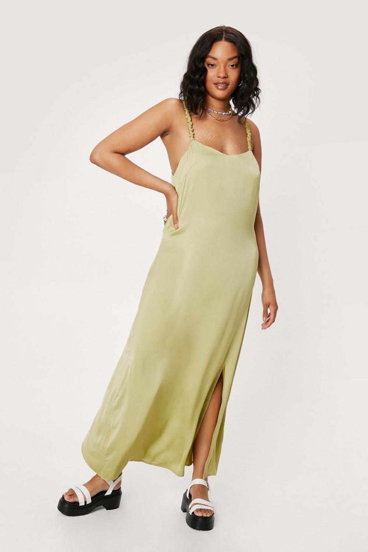 model wearing the satin dress in green