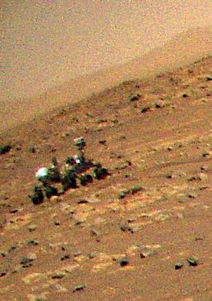 the perseverance rover as seen from the ingenuity helicopter