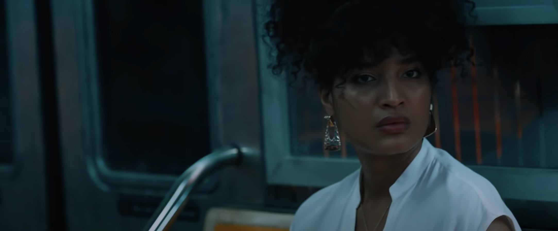 Indya Moore riding the subway in escape room