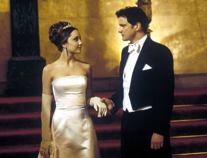 colin firth and amanda bynes holding hands while at a ball