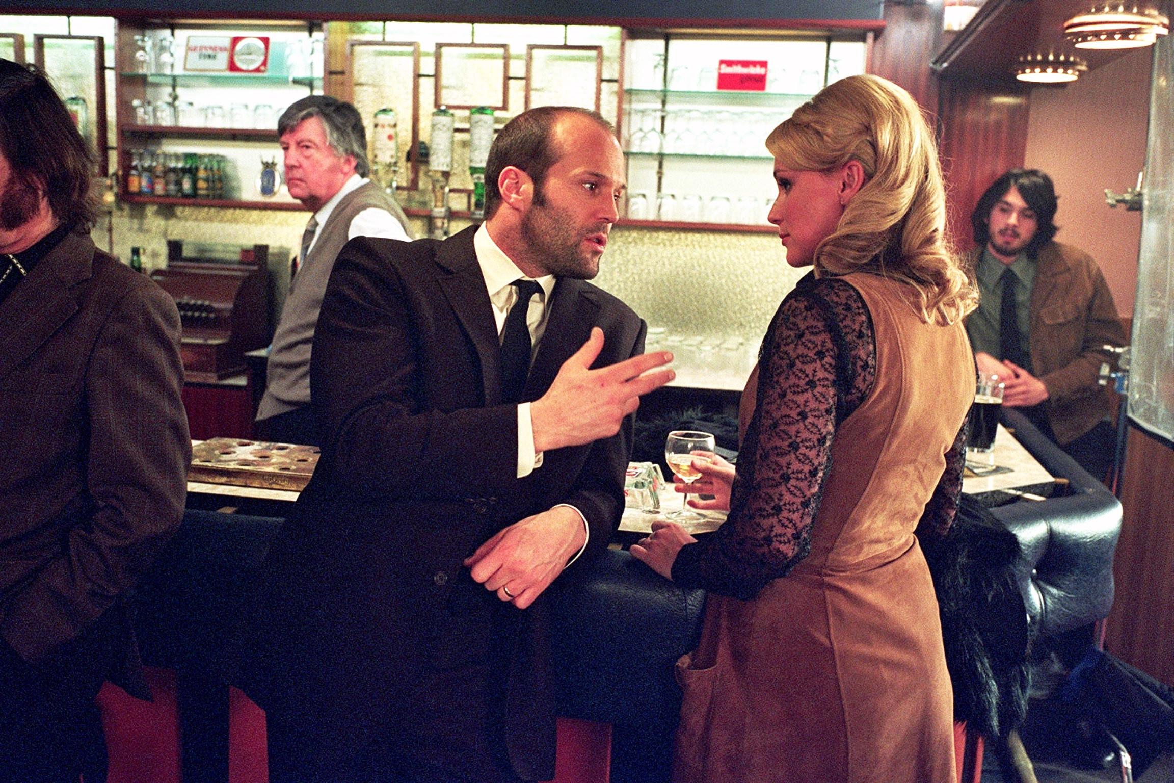 Jason Statham talking to Hattie Morahan while at a bar