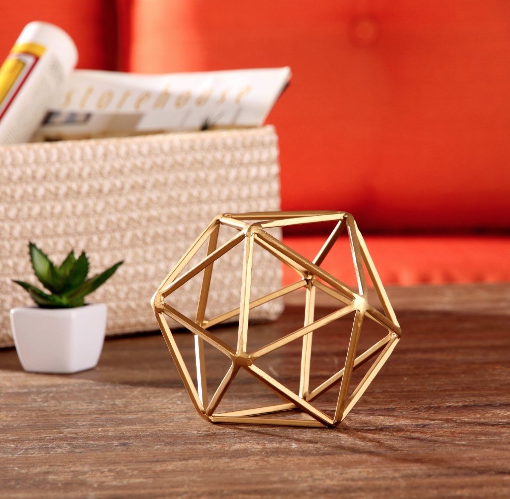 a gold geometric small sculpture