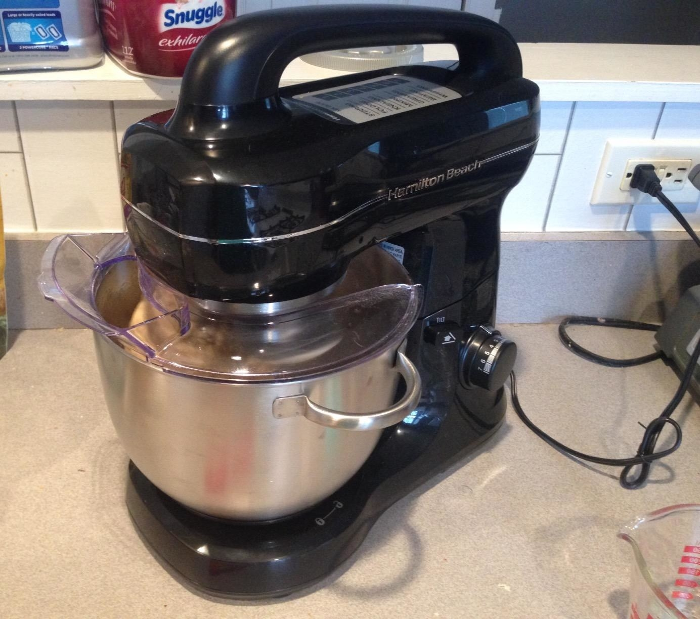 A reviewer photo of the mixer in use, with the splash guard on