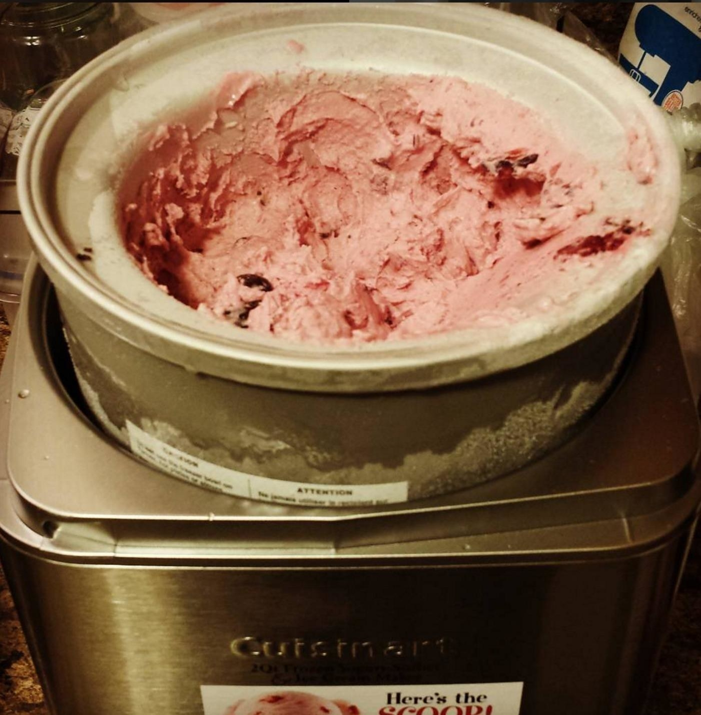 A reviewer photo of the machine in use, making strawberry ice cream