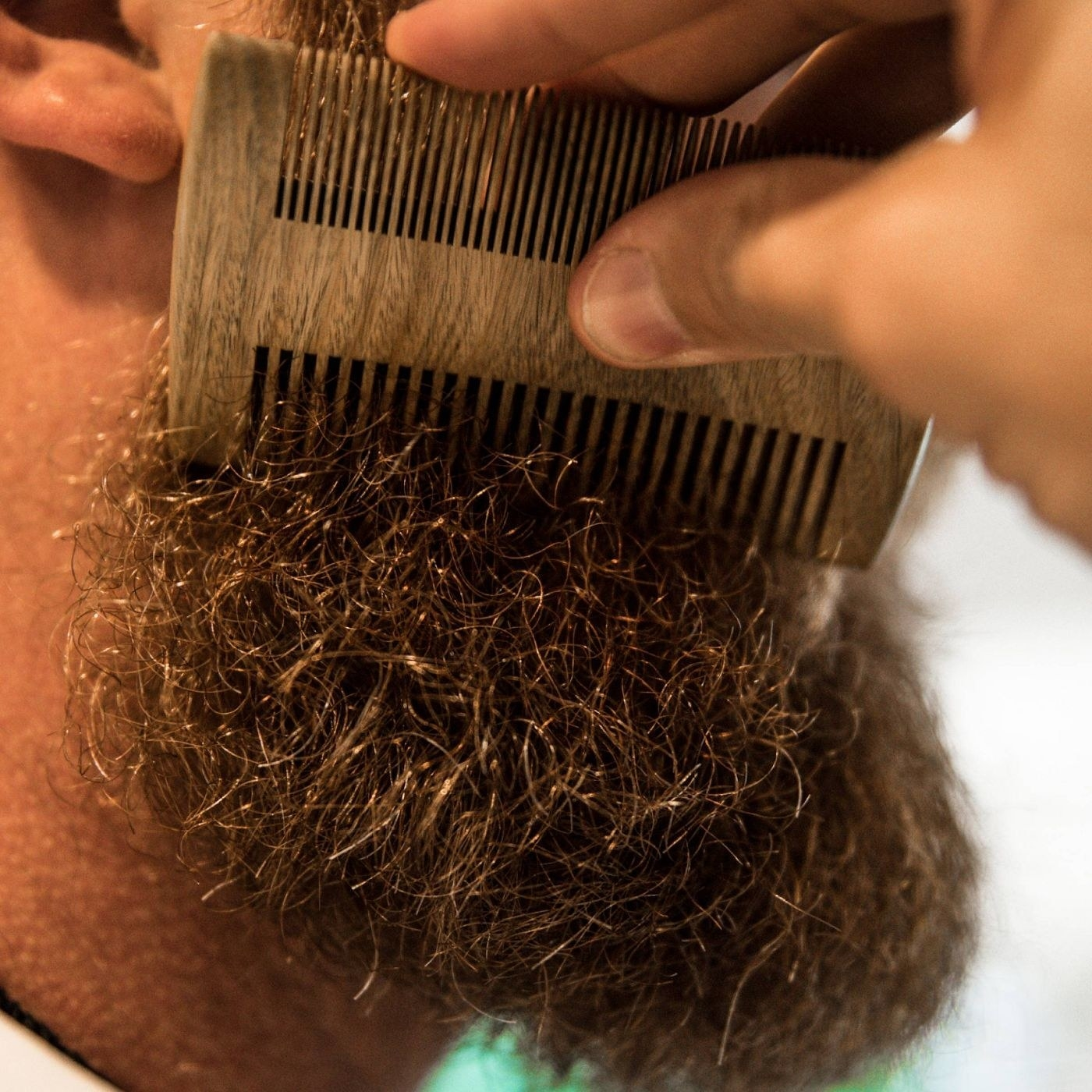 Model using the beard comb