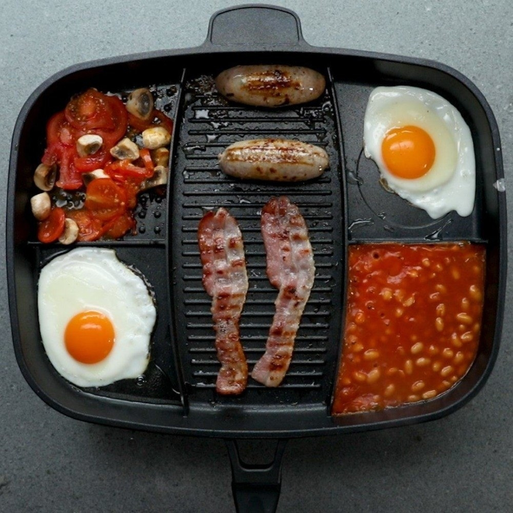 The skillets with breakfast ingredients inside