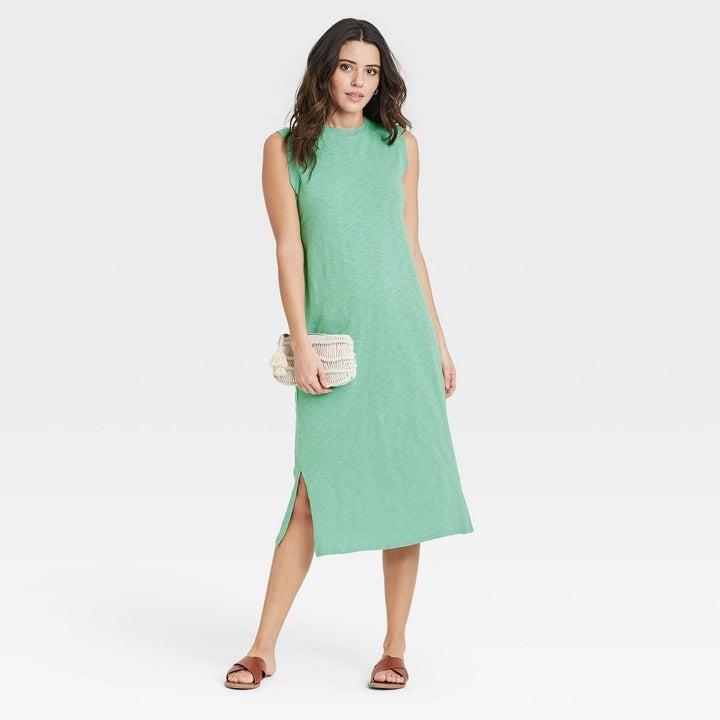 Model wearing sea green dress, goes past the knee