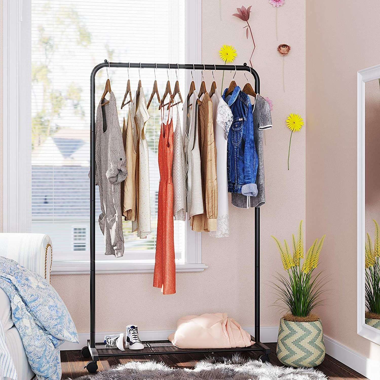 The garment rack filled with clothes in a bedroom