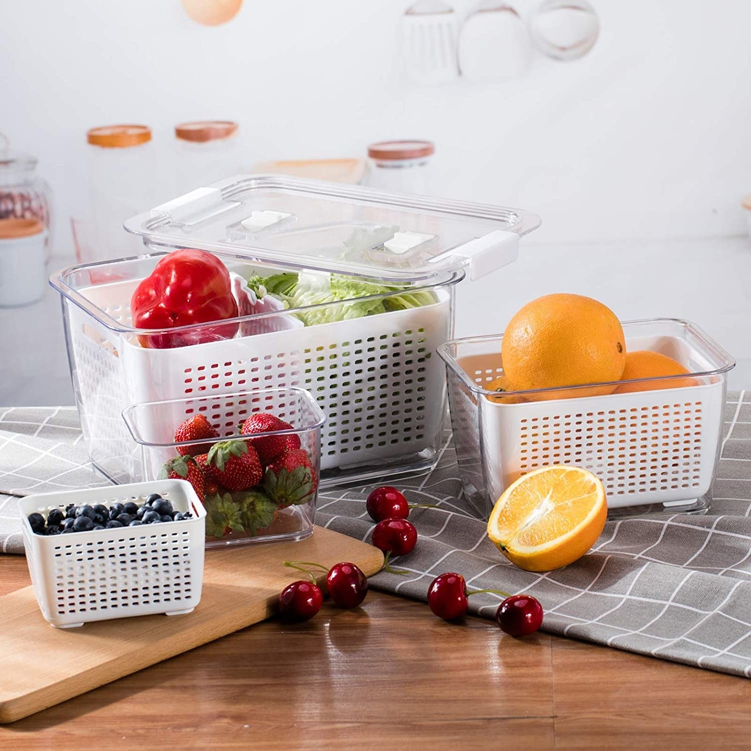 The three containers filled with fruits and veggies