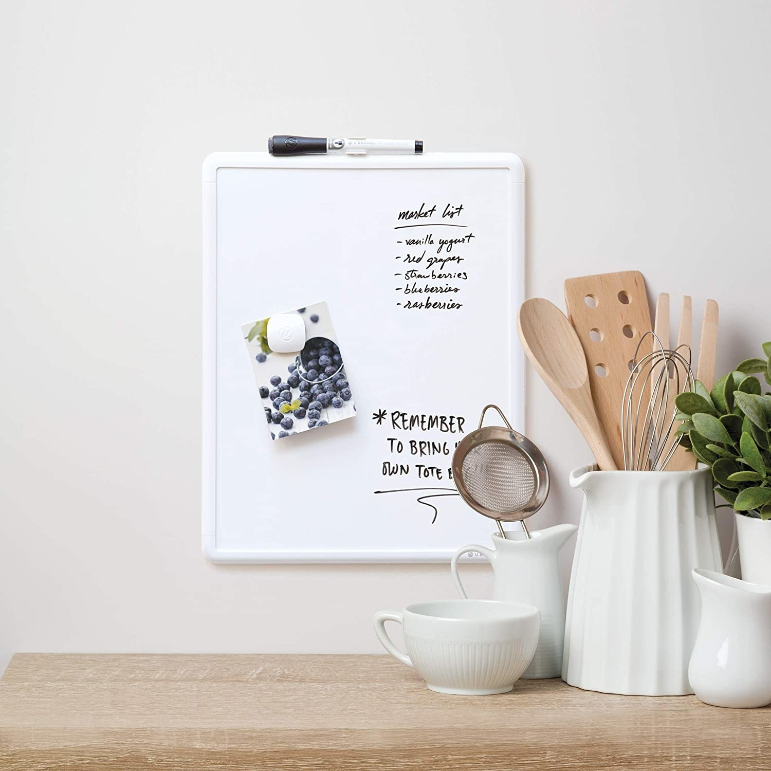 The magnetic board mounted on a kitchen wall
