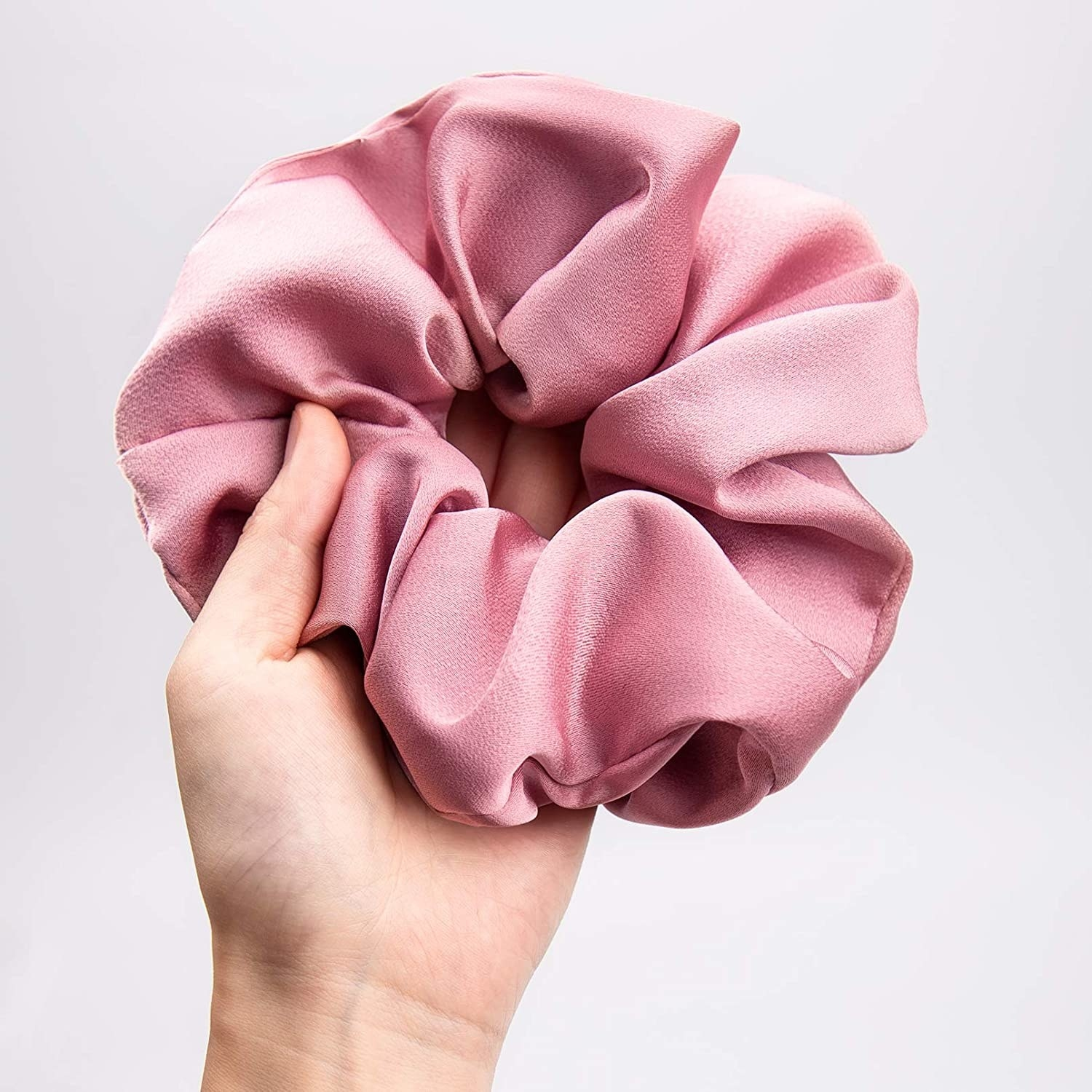 A person holding an extra-large scrunchie