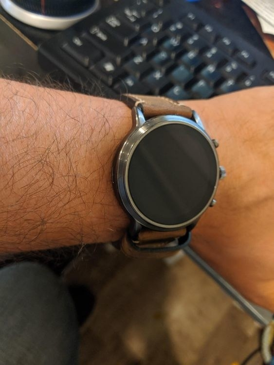 the smartwatch on a reviewer's wrist