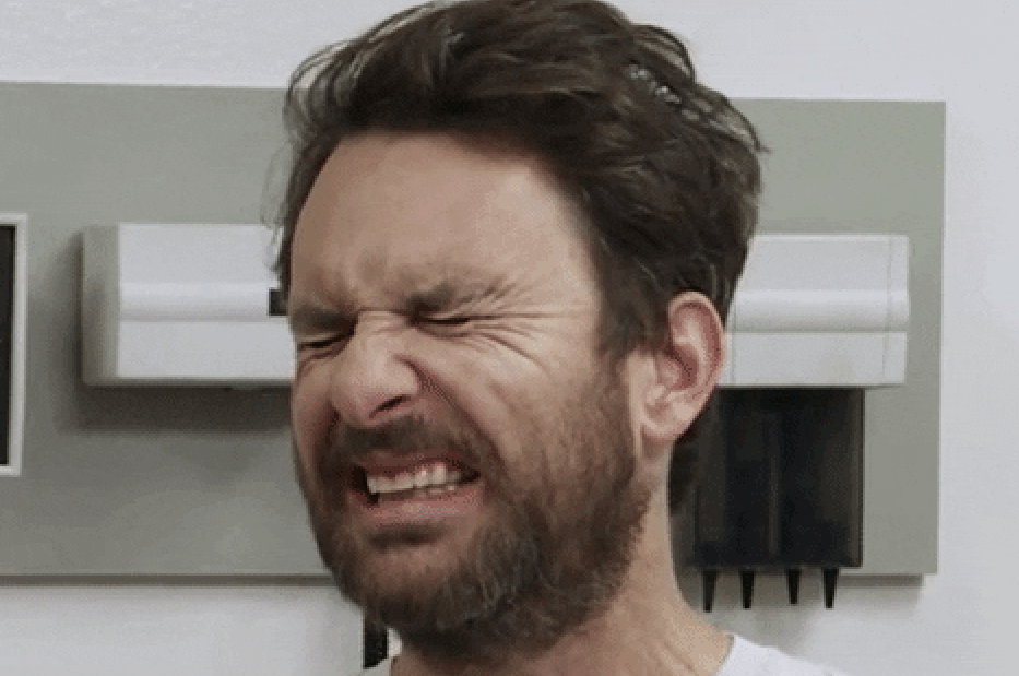 Charlie Day scrunching his face in disgust