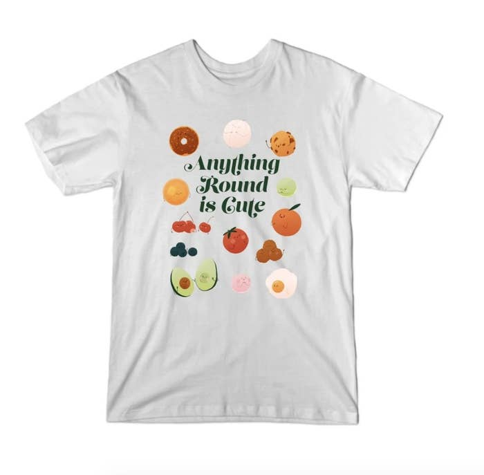 """White t-shirt that says """"Anything round is cute"""" with different food characters on it"""