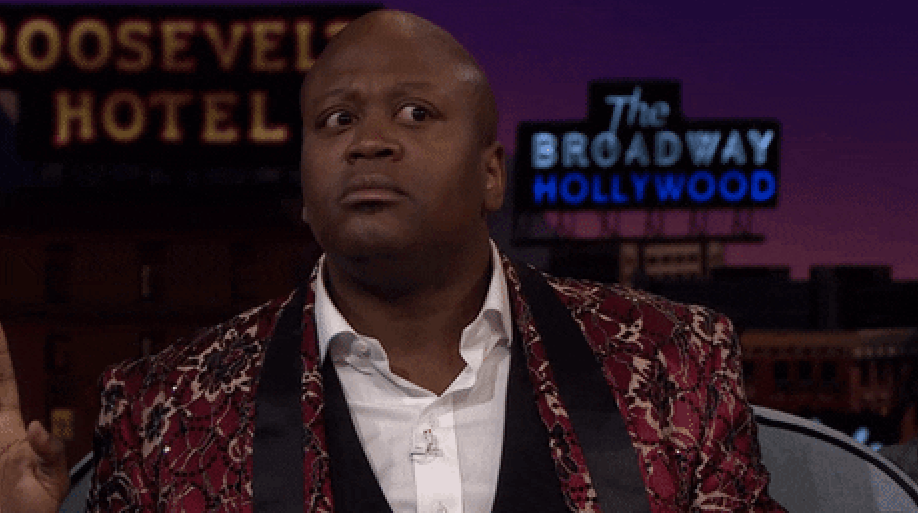 Tituss Burgess with wide eyes and nervous energy