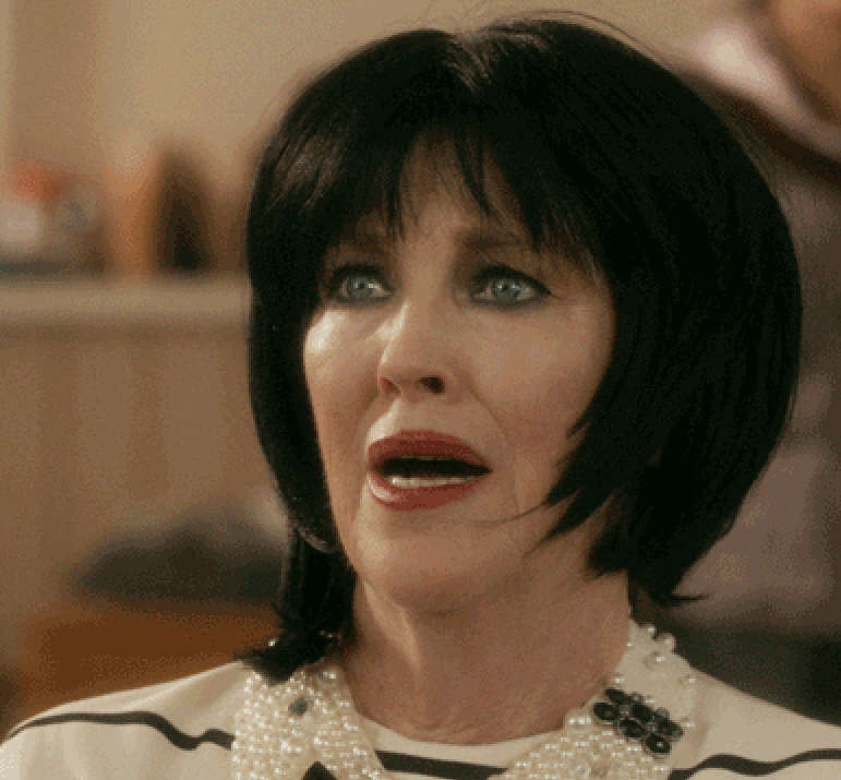 moira rose from schitt's creek with her mouth agape in shock